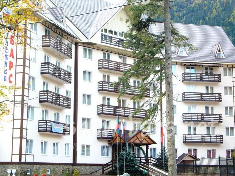 Снежный барс домбай отель
